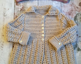 Crochet cotton baby coat in oyster with cream buttons and matching hanger