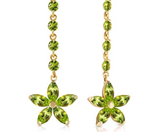 14k. solid gold chandeliers earrings with peridots. Secured by post friction Push Backs