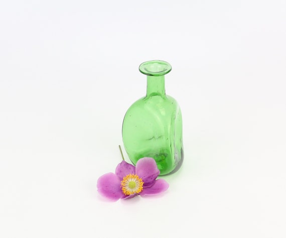 small and fine green triangular vase made of glass green glass studio glass designer glass glass art