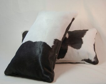 Black and white cowhide pillows