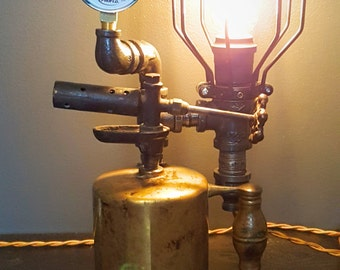 Industrial Steampunk Antique Torch Lamp with Edison Bulb and Fabric Electrical Cord.