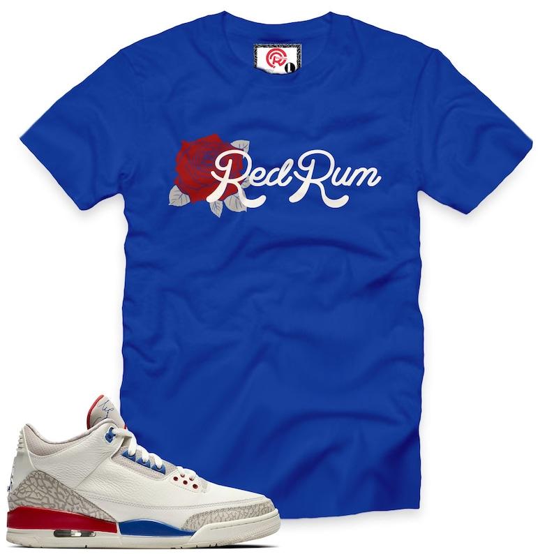 bbca49db1a2569 International Flight 3 Rose Redrum T-Shirt