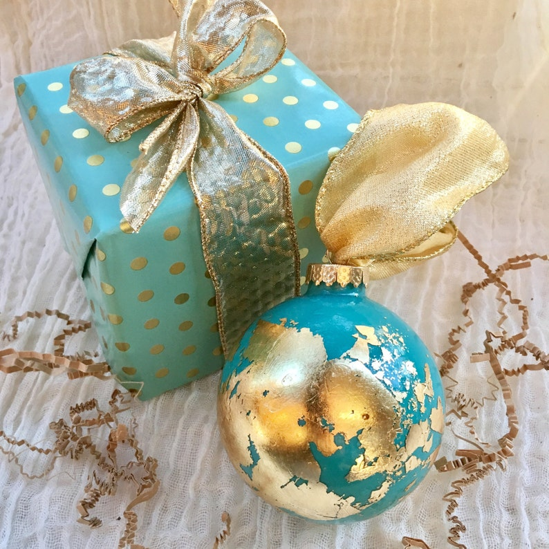 23 Best Travel Gifts for Her featured by top US travel blogger, Marcie in Mommyland: LARGE Globe Inspired Gold Leaf Ornament Gilded Glass image 0