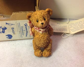 A small happy baby bear
