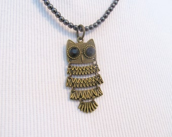 Owl necklace, antiqued brass pendant, small black beaded necklace, woman's jewelry, bird lovers necklace