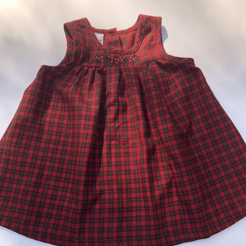 Holiday 2T Red And Green Plaid Sleeveless Dress with Embroidery of Red Flowers with White Centers and Green Leaves Embroidered Christmas
