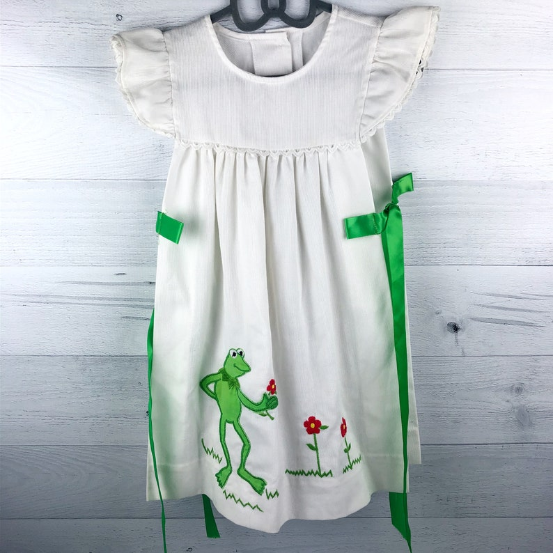 Green Ribbon Bows on Sides Lace Trim Vintage White Pinafore with Appliqu\u00e9 of Kermit from The Muppets and Embroidered Red /& Yellow Flowers
