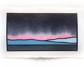 Light pink bleed, night sky with stars, over blue mountains
