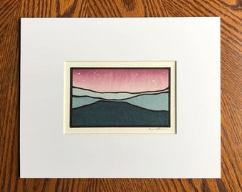Maroon sky with stars, Teal mountains