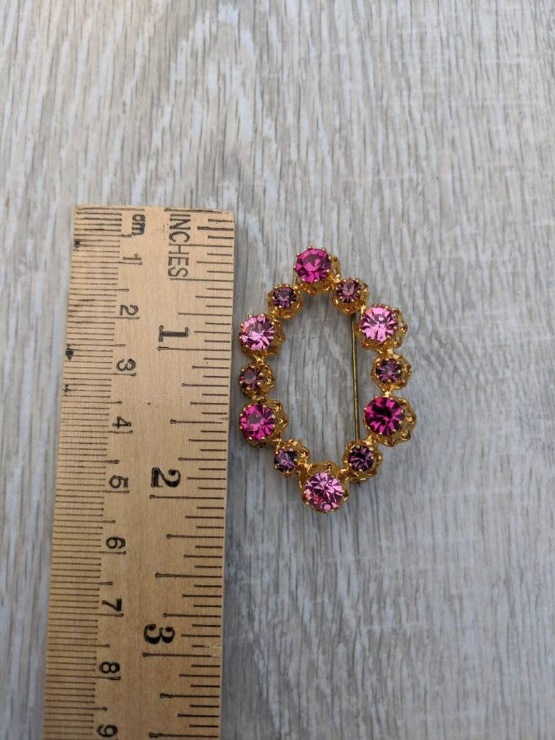 Shades of Pink and Purple Austrian Crystal and Gold Tone Metal Oval or Hexagon Brooch