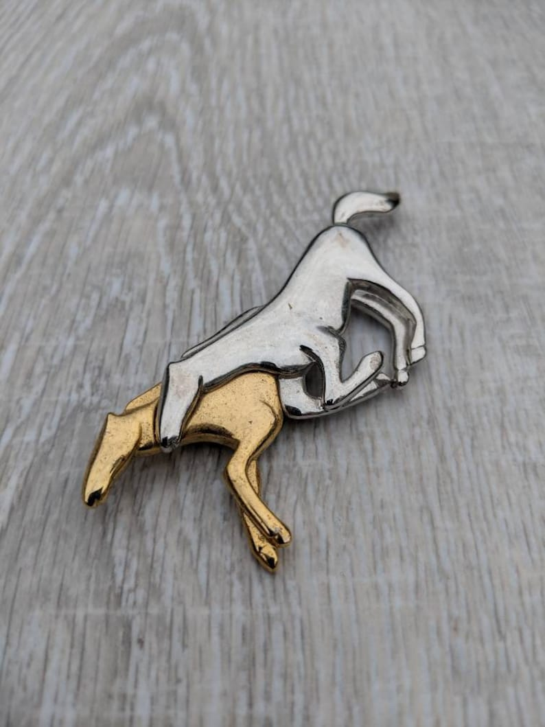 Liz Claiborne Glossy Silver Tone and Gold Tone Pair of Running Horses Brooch
