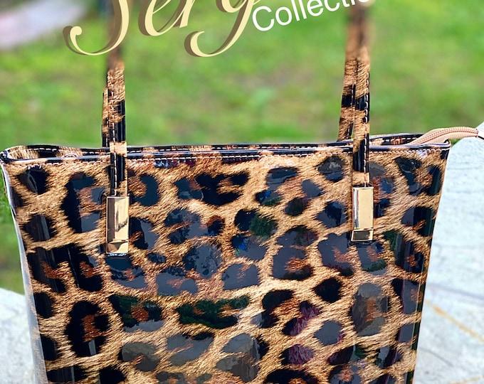 Featured listing image: Handbag, patent leather cheetah print
