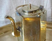 Chinese brass teapot with a strainer. Engraved with lansdscapes.