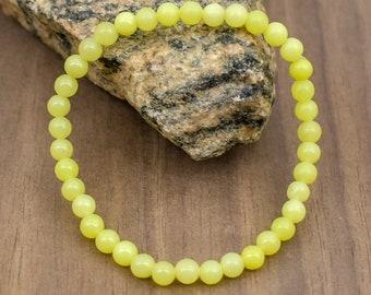 Carved Jade beads and Lemon Quartz Mother Mary bracelet.