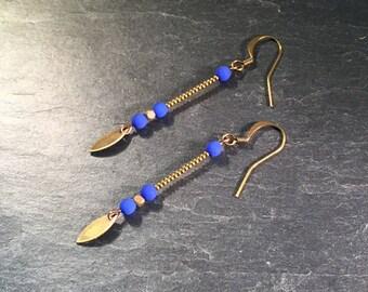 Long earrings, bronze, with cobalt blue pearls.