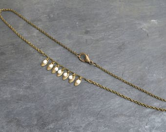 Necklace pendants and pearls.