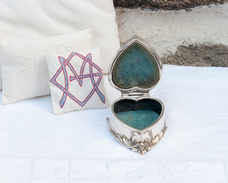 Antique silver plated jewelry box with blue velvet lining
