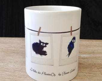 White ceramic mug with wacky creatures
