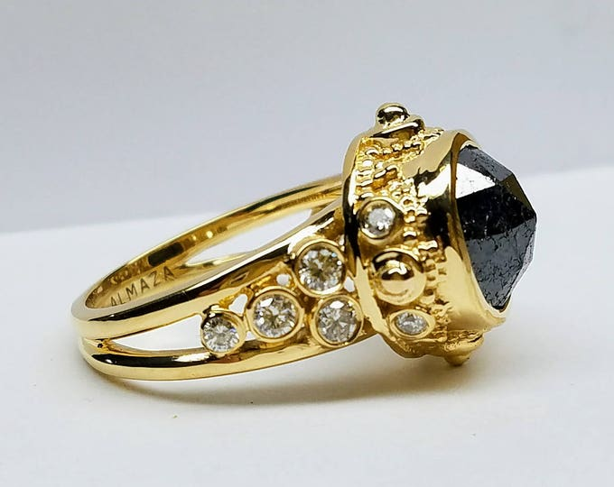 Unique one of a kind Black diamond engagement ring.