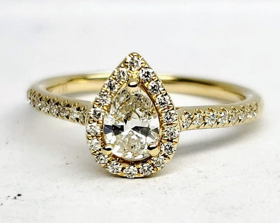 14kt yellow gold pear shape diamond engagement ring.