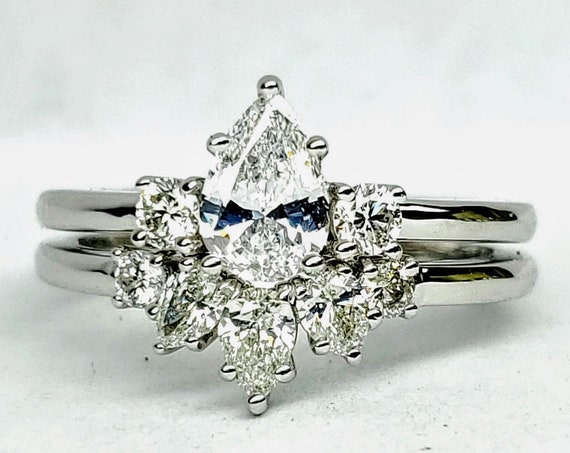 Pear shape diamond engagement and wedding set in 14kt white gold. Bridal set