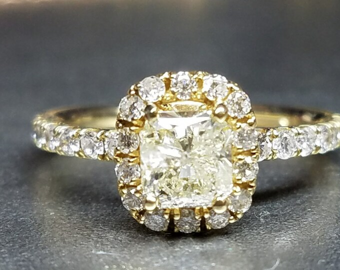 Cushion cut diamond engagement ring yellow gold.