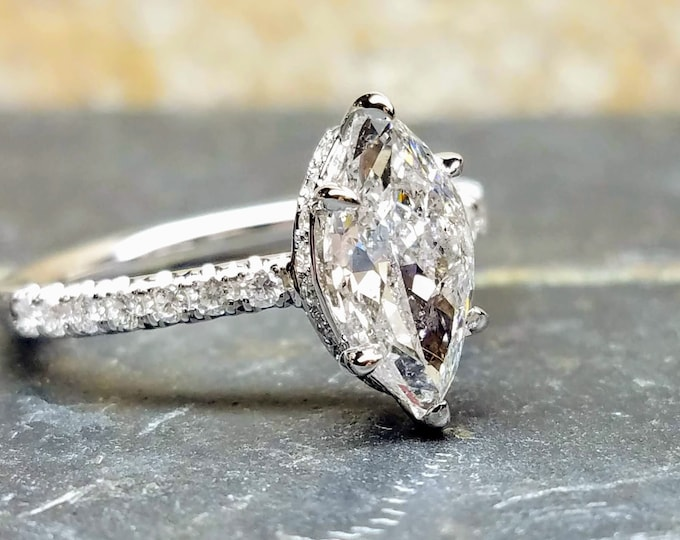 1.5 carat marquise white gold engagement ring.