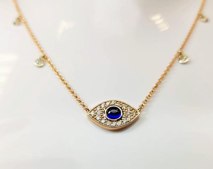 Evil eye necklace, 14kt gold and diamond Evil eye pendant.