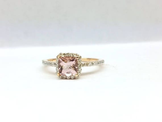 Morganite engagement ring with halo set in 14k rose gold.