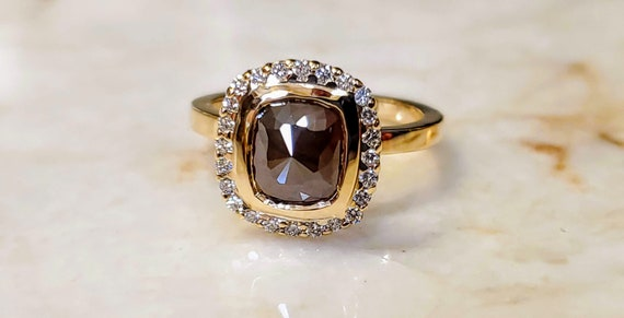 14kt yellow gold Champagne color cushion cut diamond engagement ring.