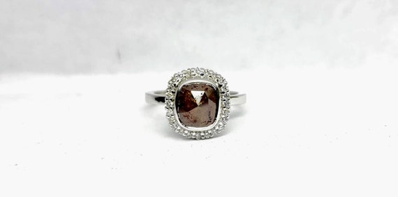 Chocolate color rose cut cushion diamond engagement ring with halo.