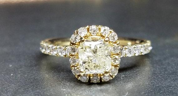 Cushion cut diamond engagement ring yellow gold.