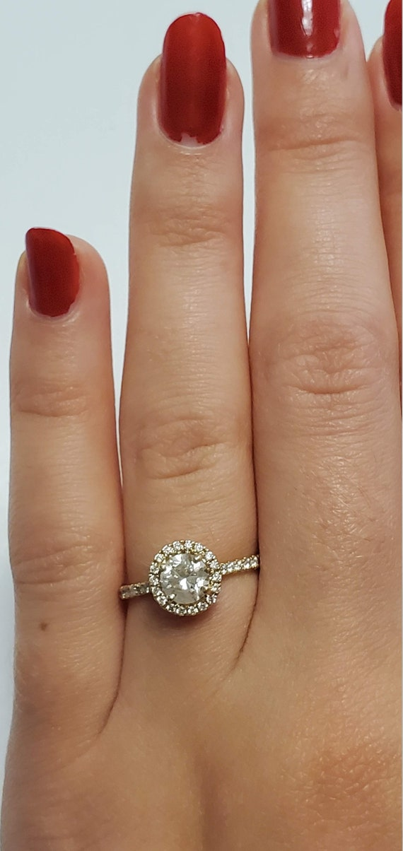 14kt Yellow gold halo diamond engagement ring.