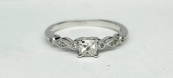 Vintage Princess cut diamond engagement ring.