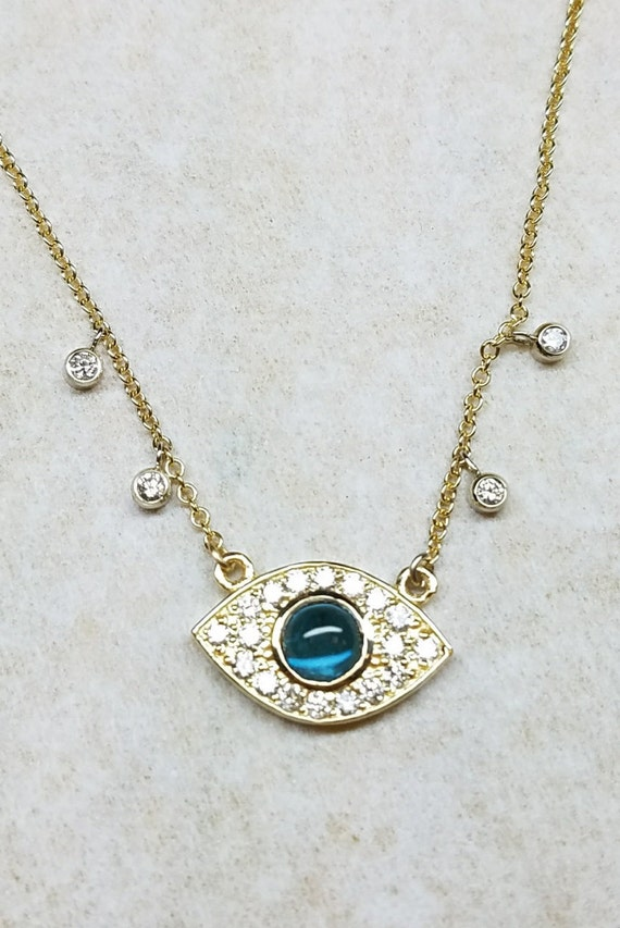 Blue evil eye diamond necklace.