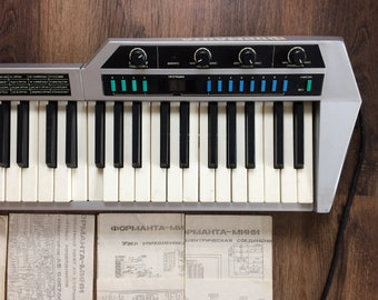 Keytar Formanta mini. Vintage eight-voice keyboard synthesizer in case. Music griffon device with scheme