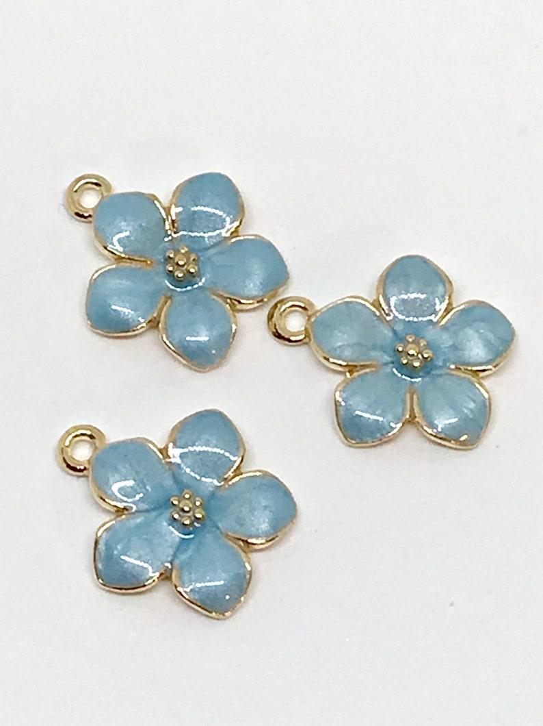 Blue Center Silver Tone Flower Earrings