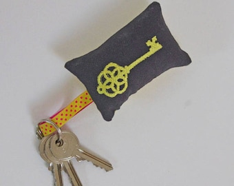 Embroidered yellow key