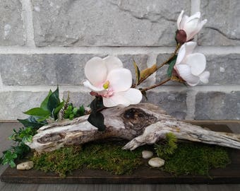 Flower arrangement centerpiece artificial pink magnolia with real driftwood and moss on a wood base