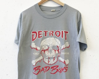 46487cd54311 Vintage Detroit Bad Boys Pistons Basketball World Champs NBA Puffy Ink  Skull Tee