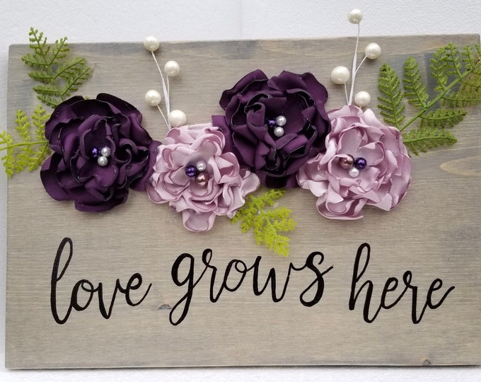 Featured listing image: Love Grows Here, Wooden sign, Hand Painted Sign, satin flowers, Rustic Decoration, Floral Decoration, Spring Decoration
