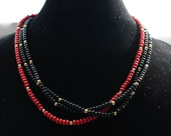 UNN # 60 Vintage Three Strand Seed Bead in Black, Red, and Gold Necklace