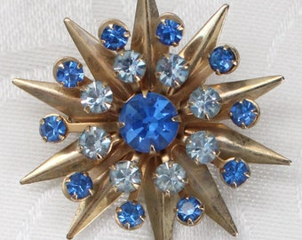 Vintage Gold Tone Sculpted Star Burst Brooch with Dark and Light Blue Clear Crystal Rhinestones