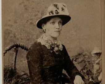 Flora - antique Carte De Visite photograph of a young lady with flowers and plants - circa 1870s - London portrait rooms Dunedin New Zealand