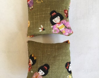 A set of two 1:12 scale dollhouse cushions