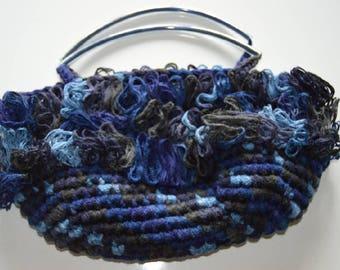 Blue and black crochet handbag