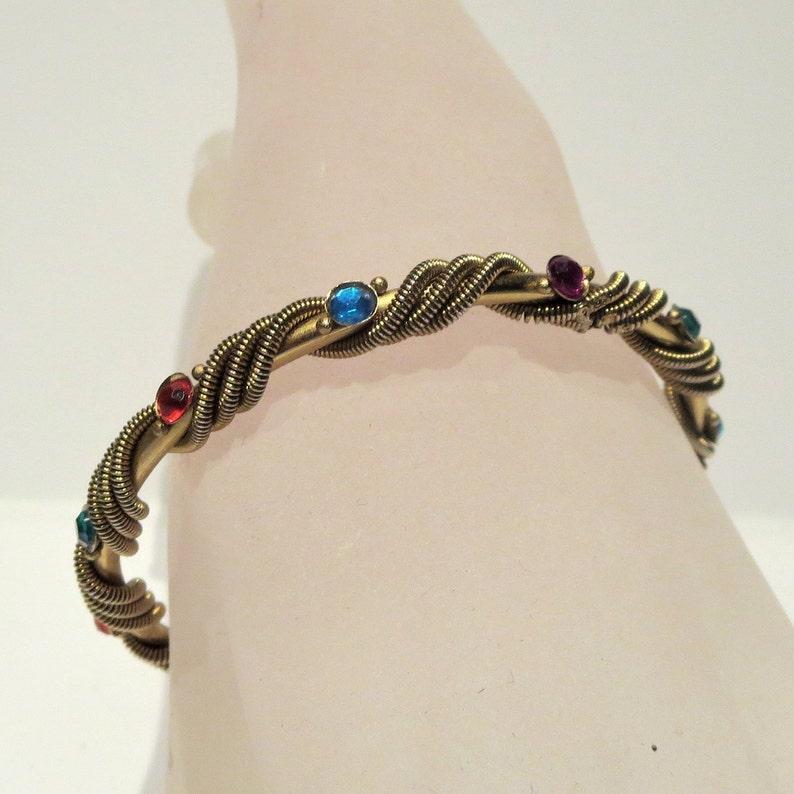 Multi Colored Rhinestone Rope Twist Gold Tone Bangle