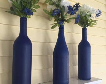 Set of three blue vases