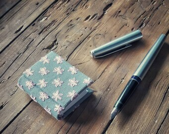 Mini notebook with hand-embroidered flowers