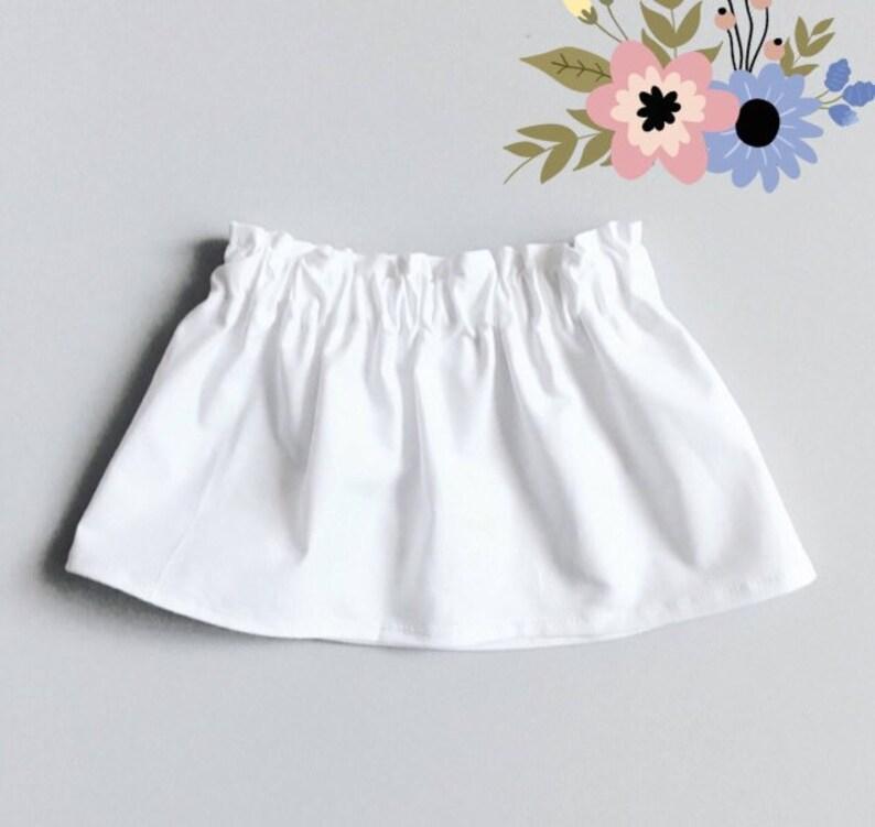 9fff88942ea Jupe blanche solide de la jeune fille Uni blanc jupe fait à